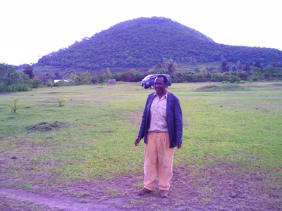 Nixon Issangya in front of the mountain which is subject in several of his books